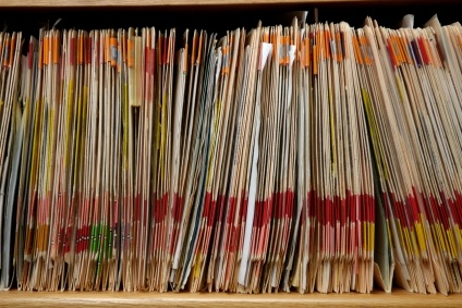 Row of medical files in a traditional office practice