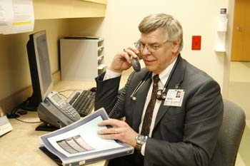 Doctor talking to a patient on the phone